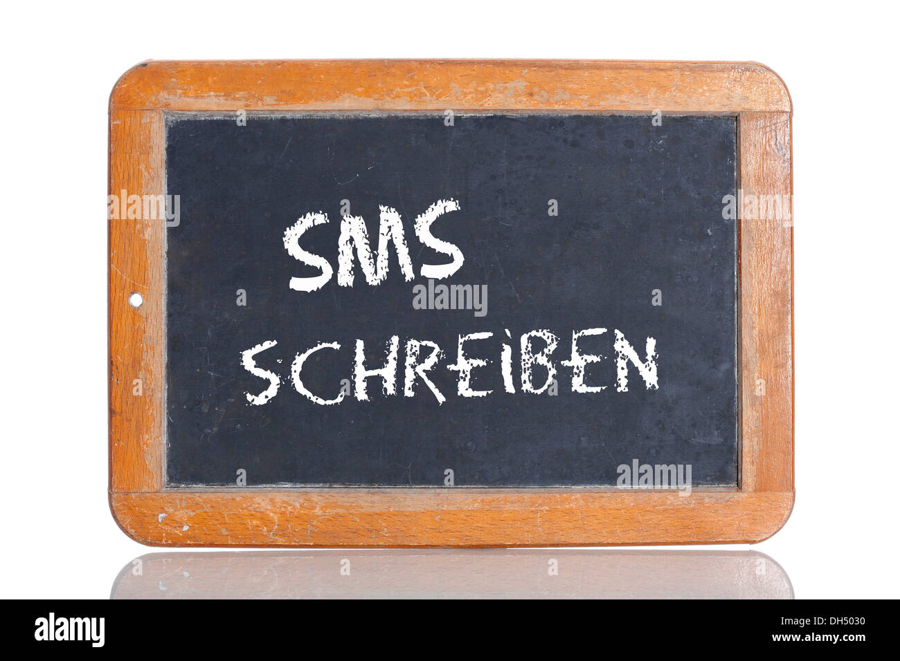 Old chalkboard, lettering 'SMS SCHREIBEN', German for 'WRITE A TEXT MESSAGE' - Stock Image