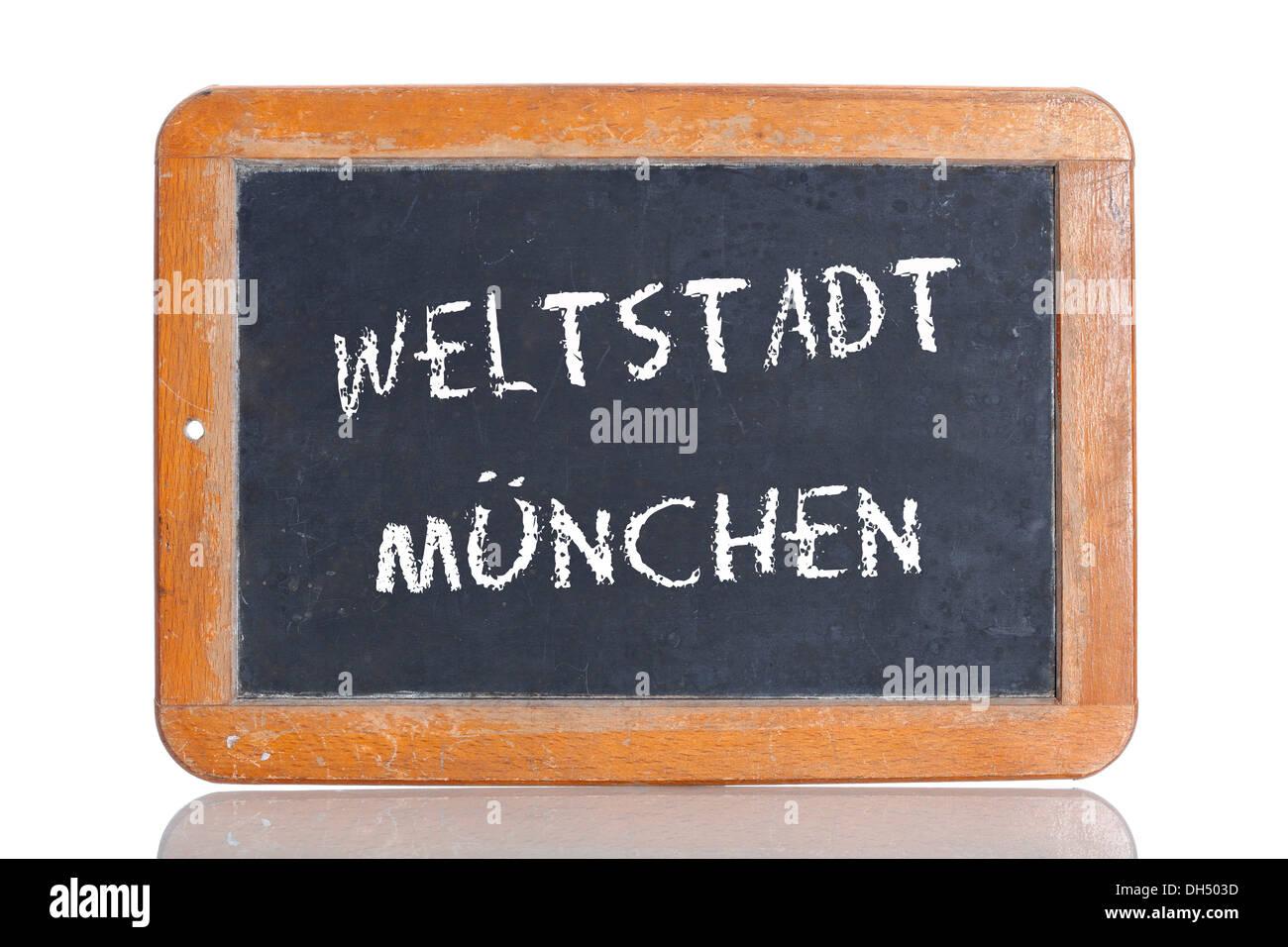 Old chalkboard, lettering 'WELTSTADT MUENCHEN', German for 'WORLD CITY OF MUNICH' - Stock Image
