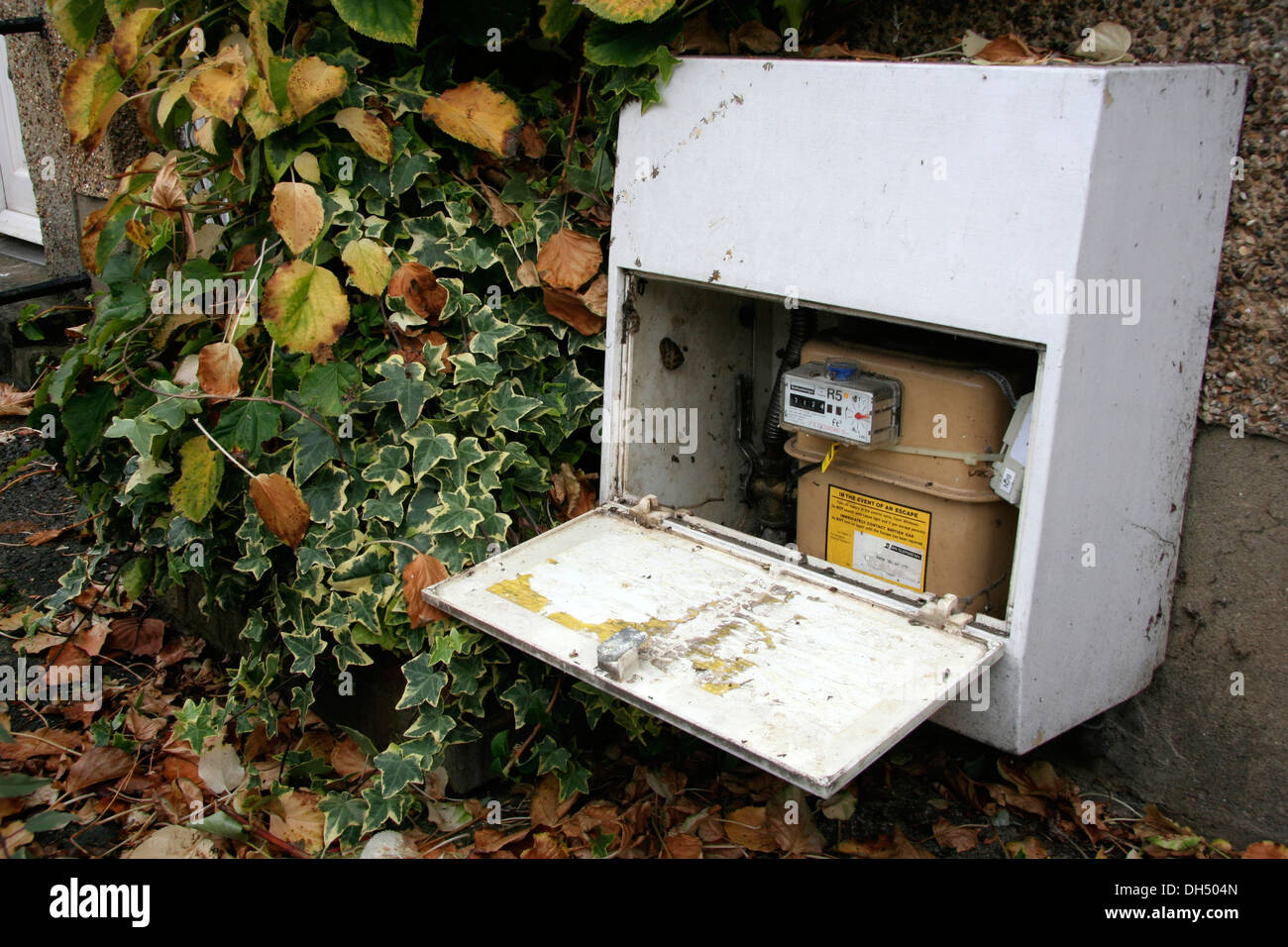 A uk gas meter opened and ready to be read during the Autumn Period - Stock Image