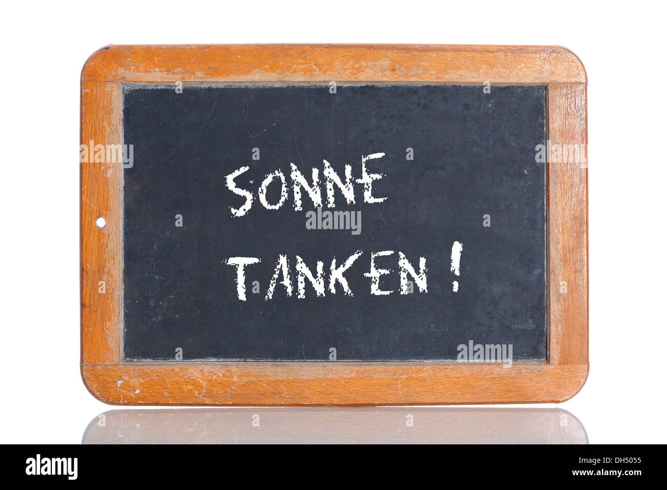 Old chalkboard, lettering 'SONNE TANKEN', German for 'SOAK UP SOME SUN' - Stock Image