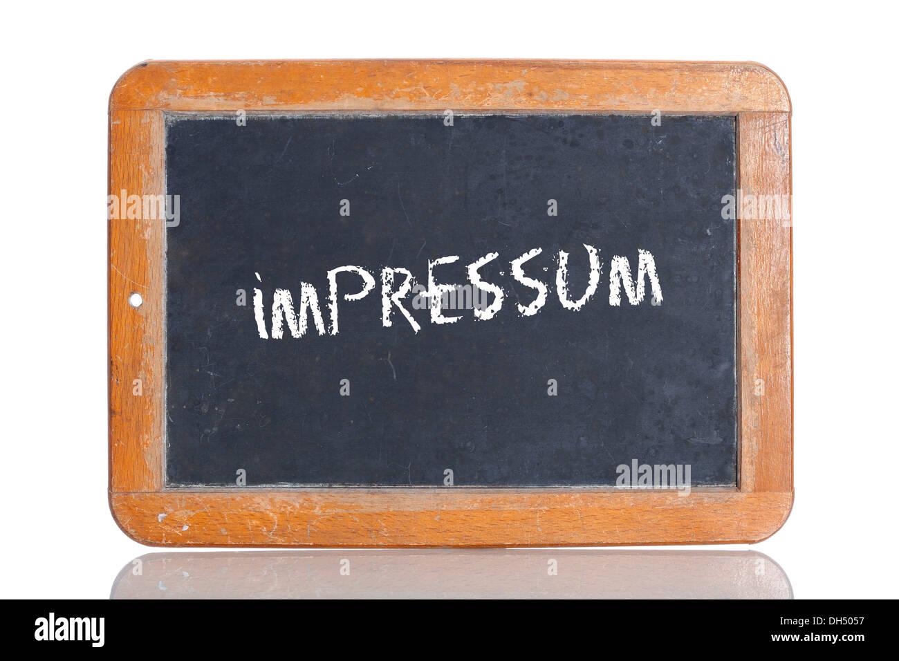 Old chalkboard, lettering 'IMPRESSUM', German for 'IMPRINT' - Stock Image