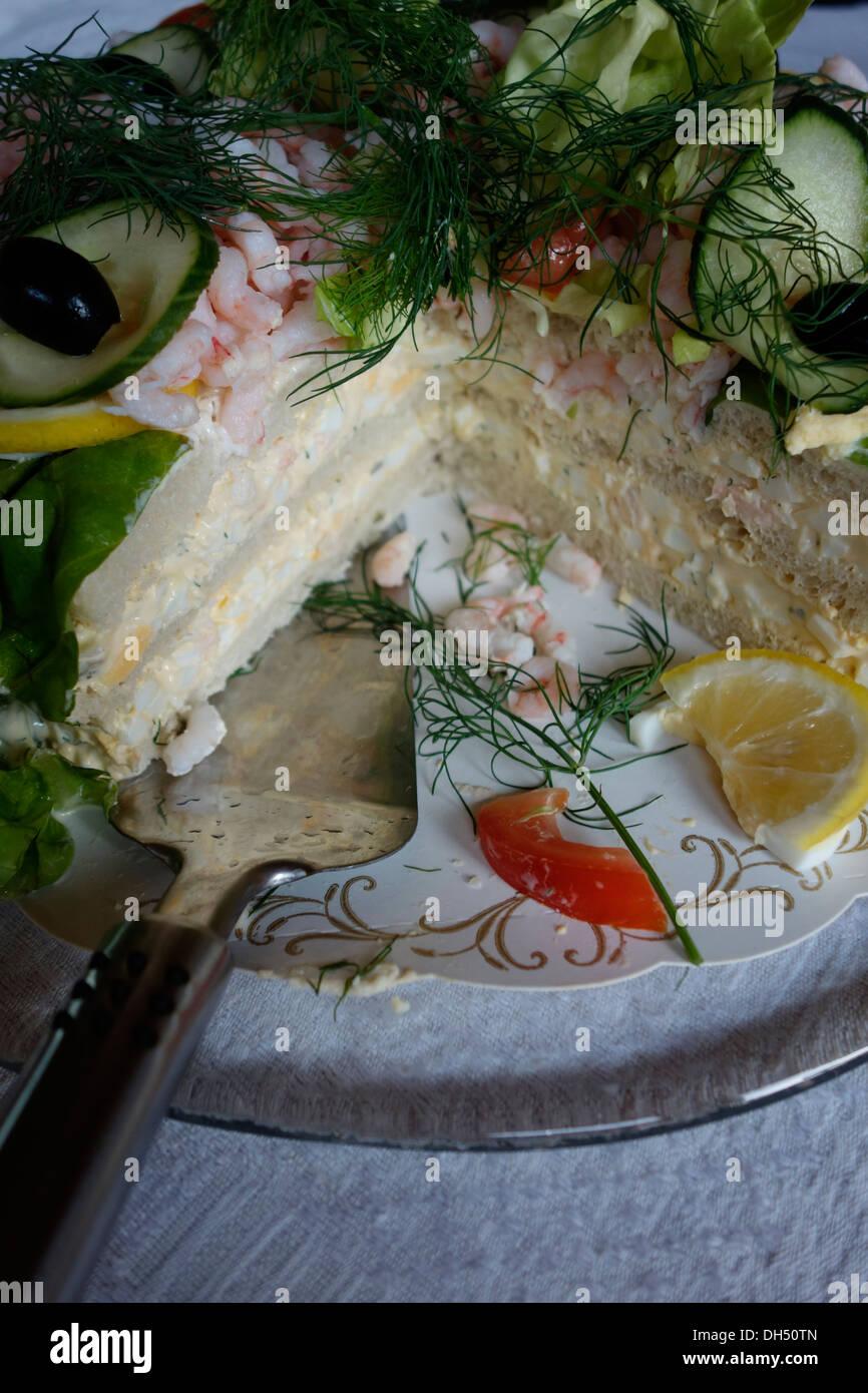 Smörgåstårta or Sandwich-cake. A hearty Scandinavian cuisine dish. - Stock Image