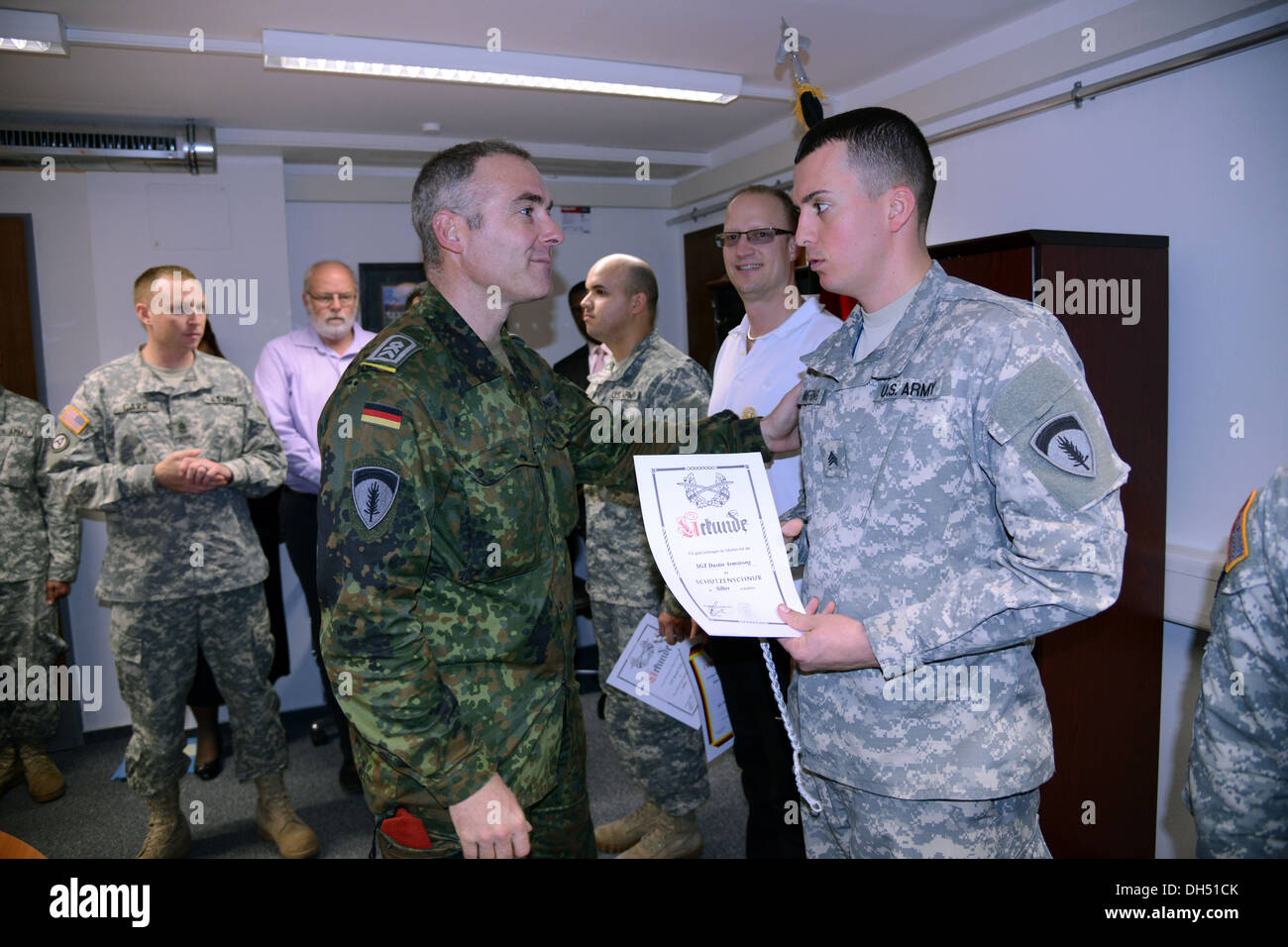 Five soldiers were presented with German Armed Forces Badge for Military Proficiency by Major Markus Hafner, a soldier Stock Photo