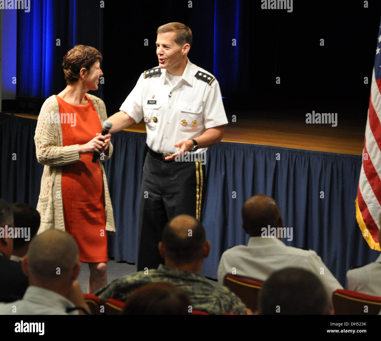 Lt. Gen. Jeffrey Talley, Chief of Army Reserve and Commanding General of US Army Reserve Command, passes the microphone to his wife Linda during a town hall meeting today at the Pentagon. Mrs. Talley urged the audience to recognize the families and friend - Stock Image