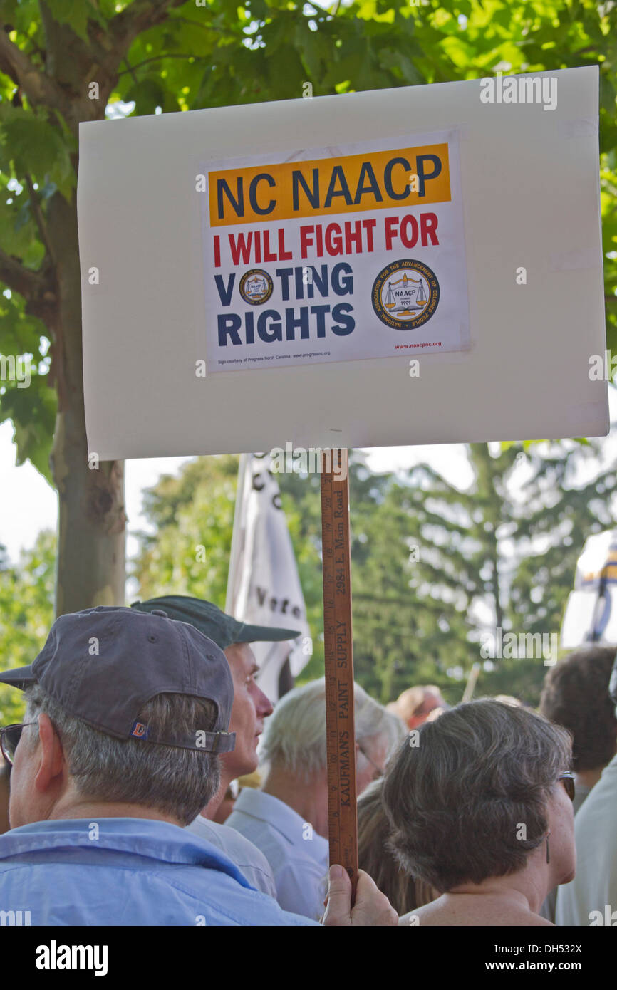 A white man holds a NAACP sign saying he will fight for voting rights at a Moral Monday rally in Asheville, North Carolina, USA - Stock Image