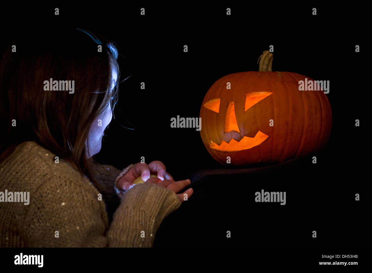 Northampton, UK. 31st October 2013. Grandad and Grandaughter after carving a pumpkin for Halloween Credit:  Keith J Smith./Alamy Live News - Stock Image