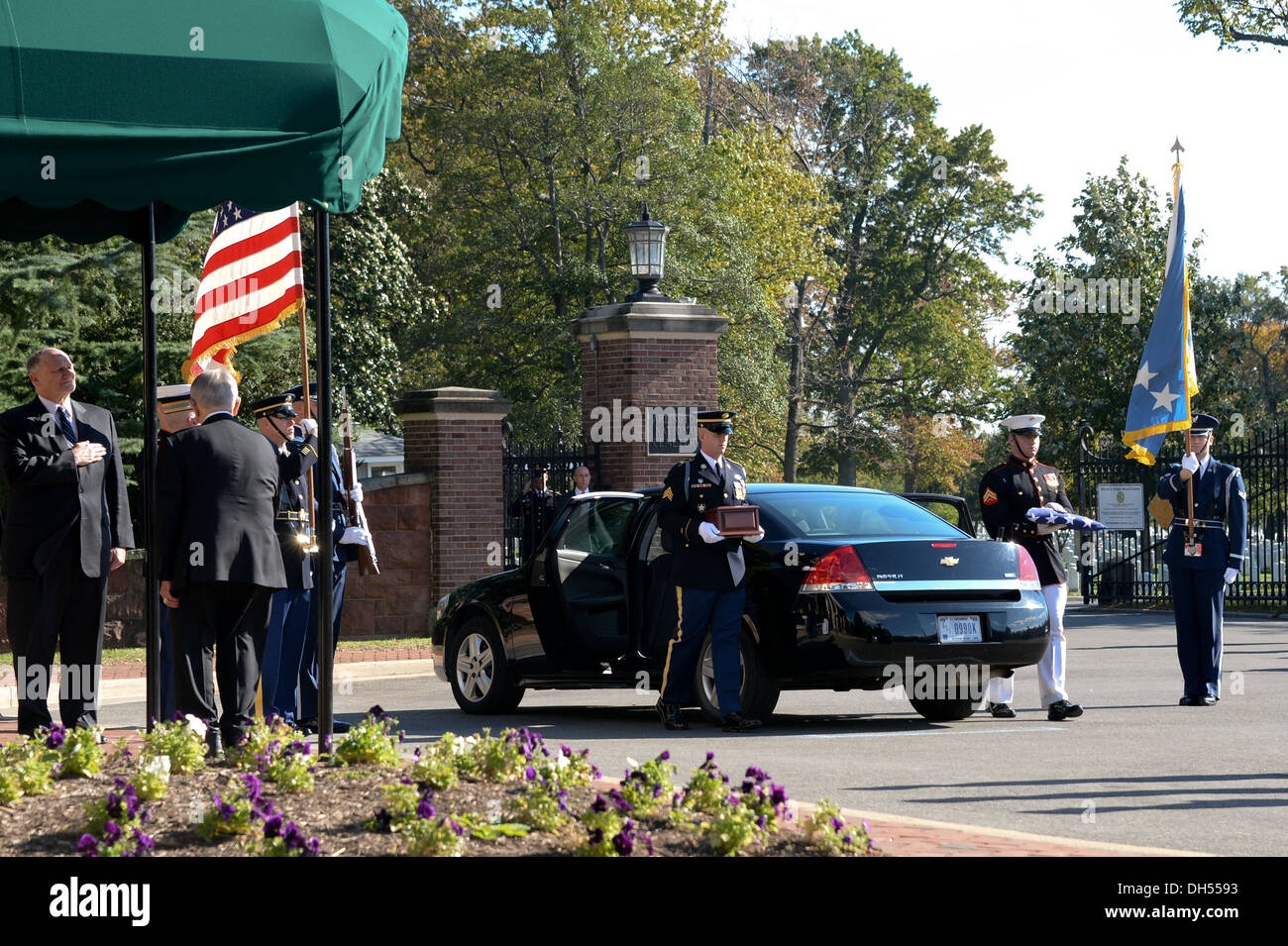 U.S. Service members of the Honor Guard remove the remains of Gen. David C. Jones, former Chairman of the Joint Chiefs of Staff, at the Old Chapel on Joint Base Myer Henderson-Hall, Arlington, Va., Oct. 25, 2013. - Stock Image