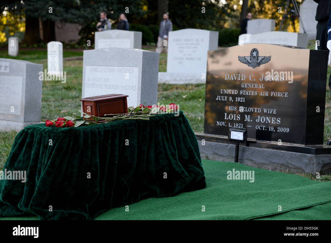The remains of Gen. David C. Jones, former Chairman of the Joint Chiefs of Staff, is surrounded by roses lain by his family members at Arlington, Va., Oct. 25, 2013. - Stock Image