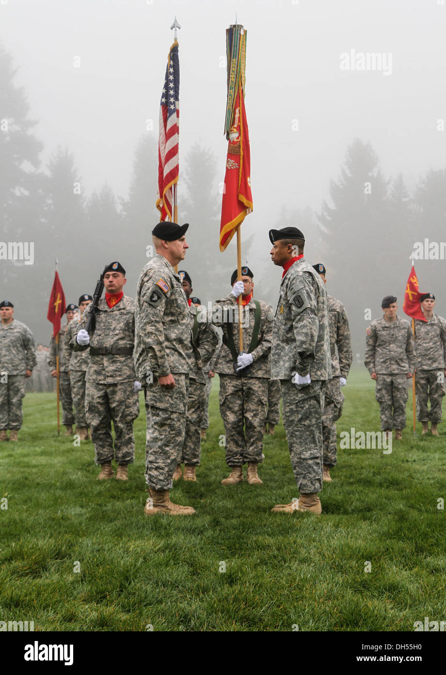 Lt. Col. Alan R. Wagner, the battalion commander for 1st Battalion, 377th Field Artillery Regiment, 17th Fires Brigade, 7th Infantry Division, prepares to case the unit colors alongside Command Sgt. Maj. Walter D. Overton, the 1-377 FA command sergeant ma - Stock Image