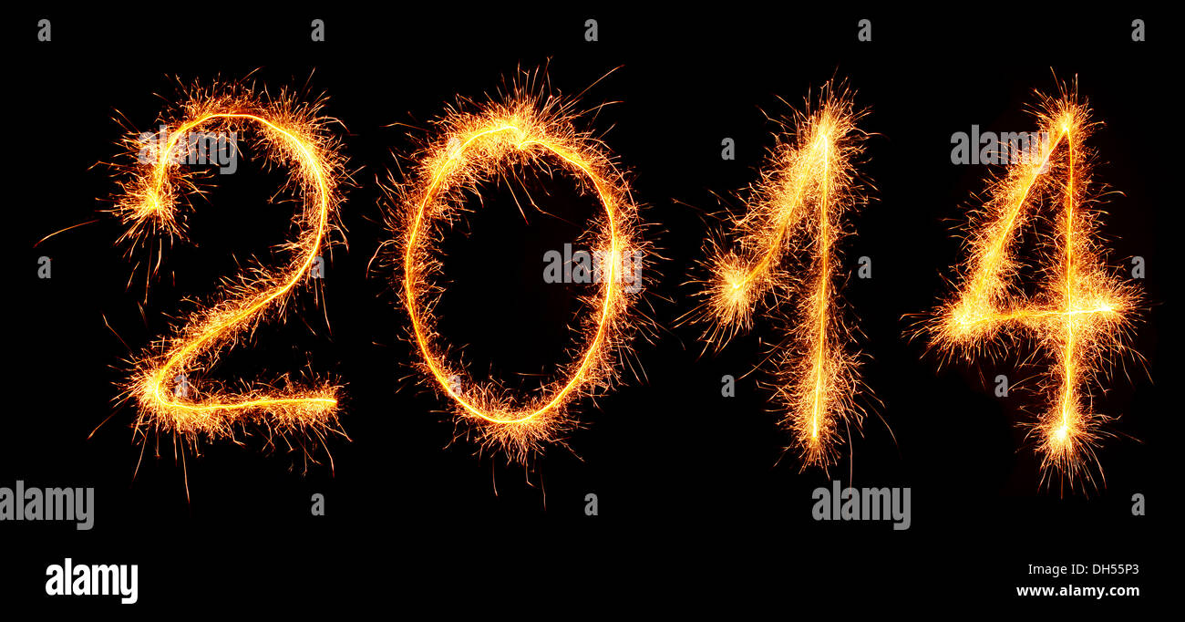 New Year 2014 made with sparklers on a dark background. - Stock Image