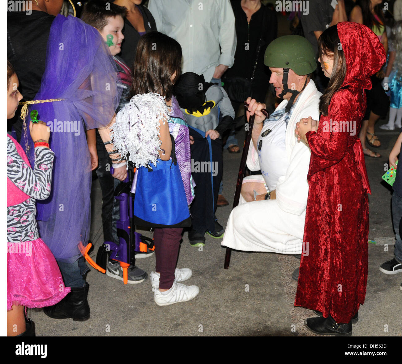 Col. Brian Gibson, the commander of the 69th Air Defense Artillery Brigade, judges the costume contest for children ages 6-12 at the Fall Festival here, Oct. 26. - Stock Image