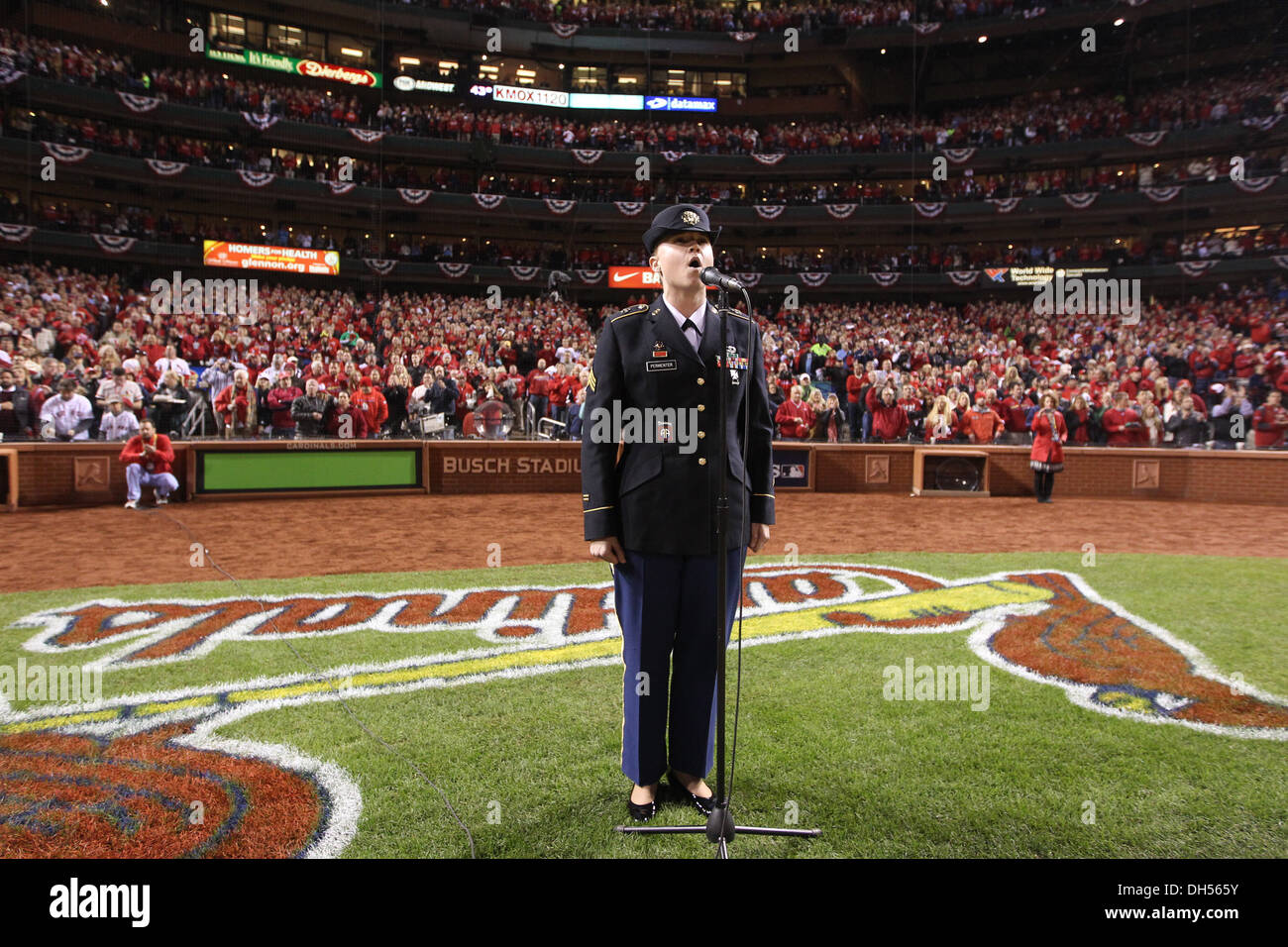 Sgt. Christine Permenter, member of the 399th Army Band, sings 'God Bless America' during the 7th inning stretch at Game 4 of the 2013 World Series, Oct. 27, 2013. - Stock Image