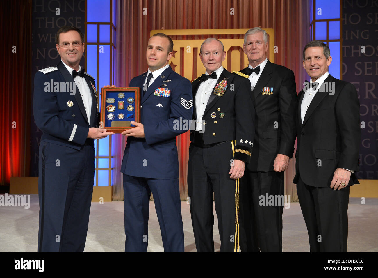 New York Air National Guard Staff Sgt. Christopher Petersen ( second from left) receives a plaque recognizing him as the USO's N - Stock Image