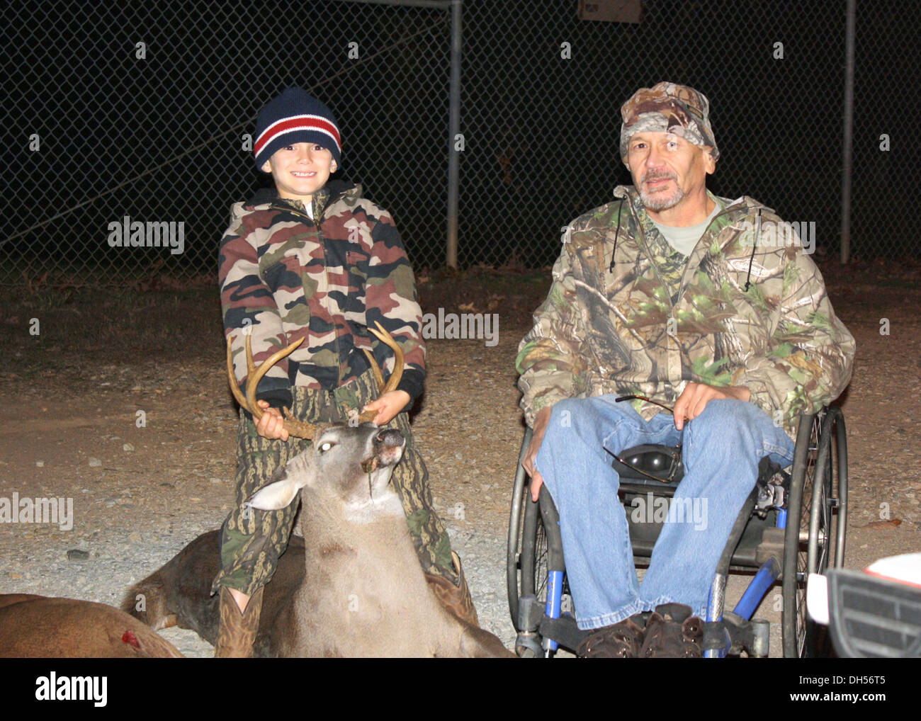 Paralyzed Veterans of America (PVA) member Ricky Pless and his grandson Landon pose with a deer that Ricky harvested Oct. 23 at - Stock Image