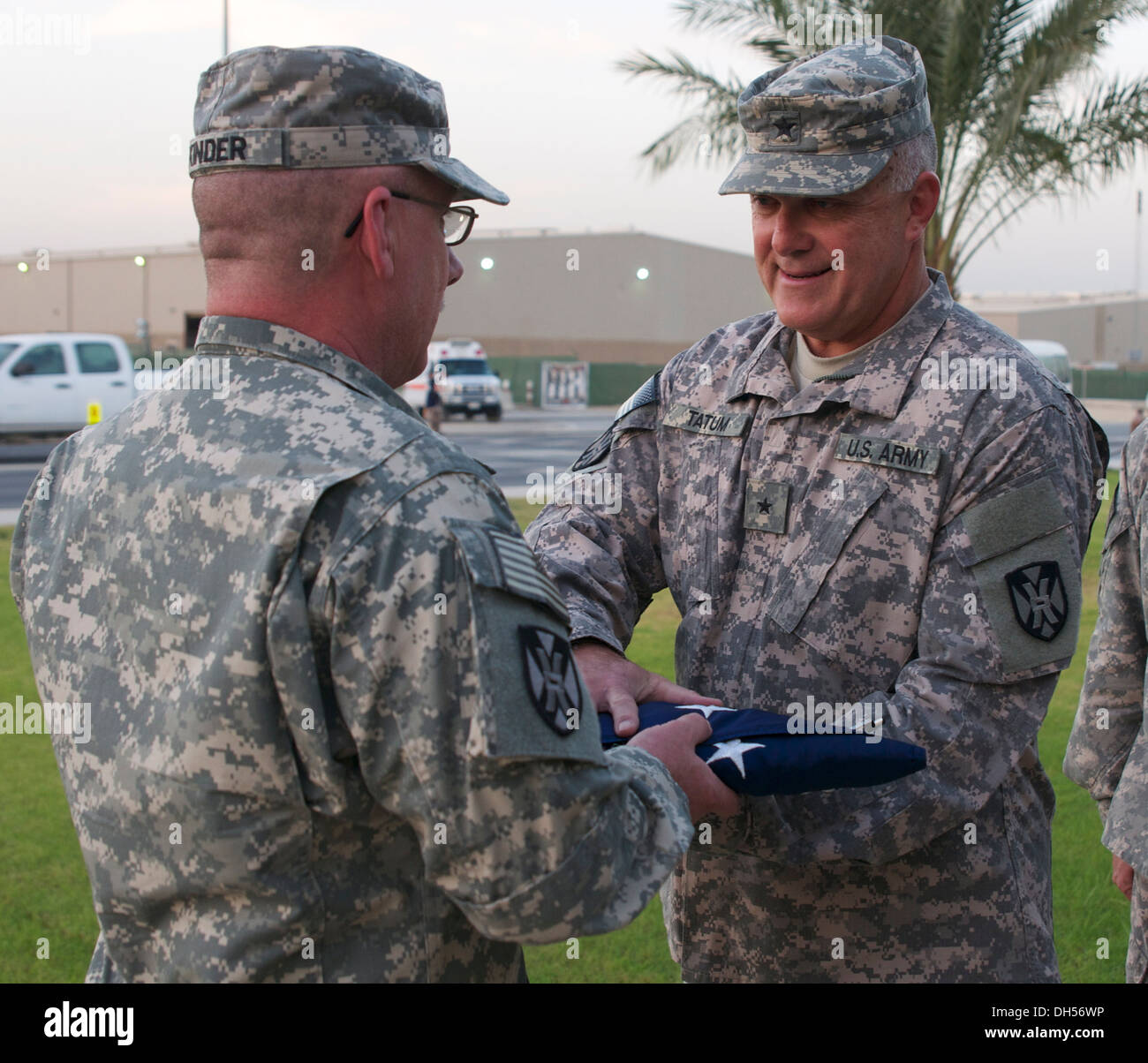 Minutes after the sound of reveille echoed throughout Camp Arijan, Kuwait, Command Sgt. Maj. Clark Kinder, command sergeant majo - Stock Image