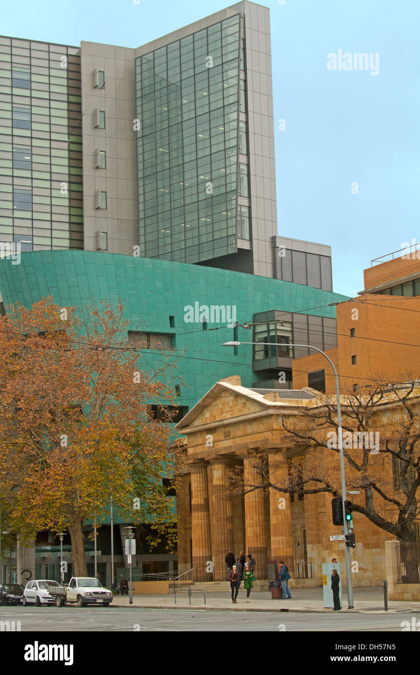 Elegant 19th century sandstone building and modern concrete and glass structure  side by side in city of Adelaide SA - Stock Image