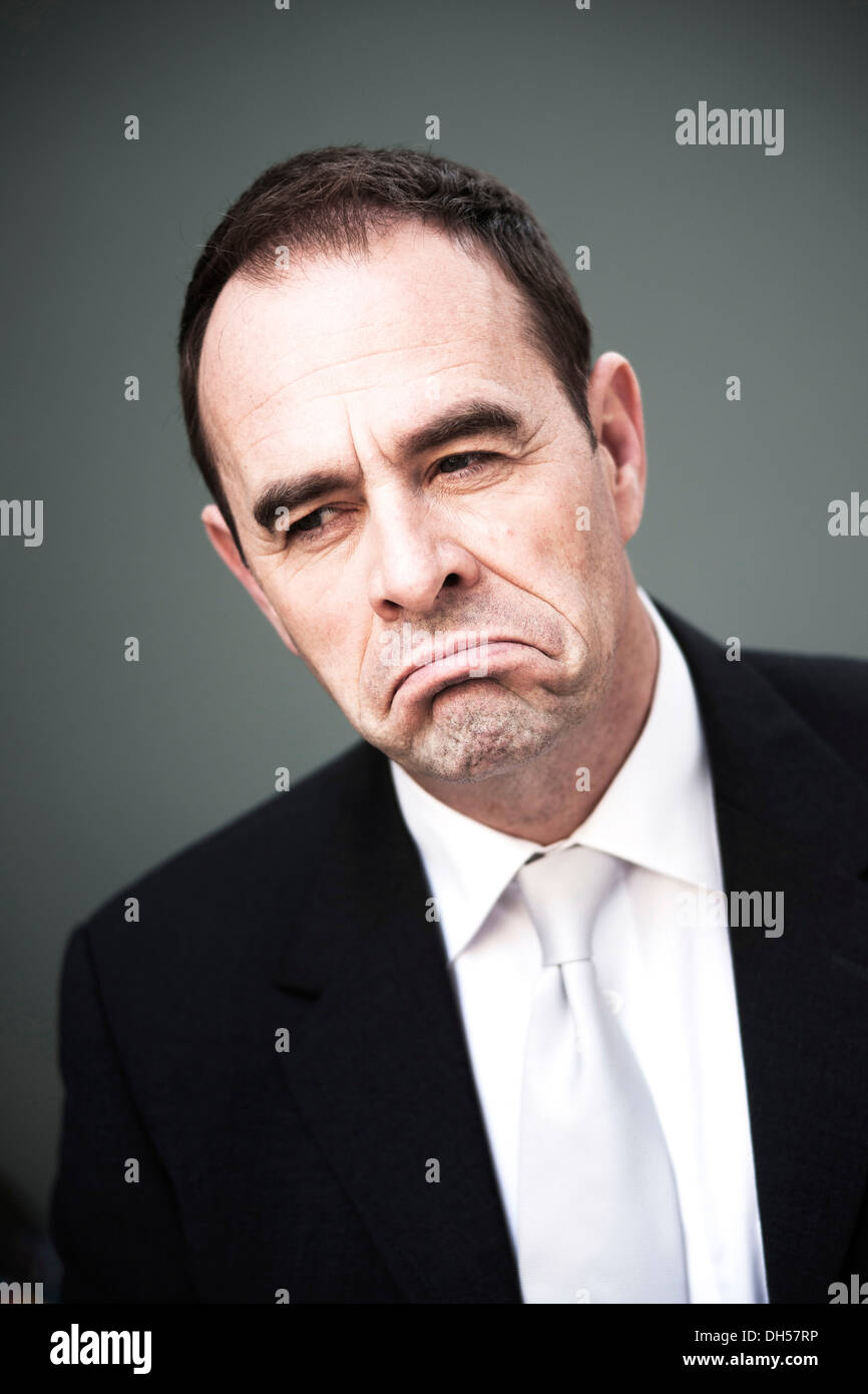 Businessman, dissatisfied, portrait, Mannheim, Baden-Württemberg, Germany - Stock Image