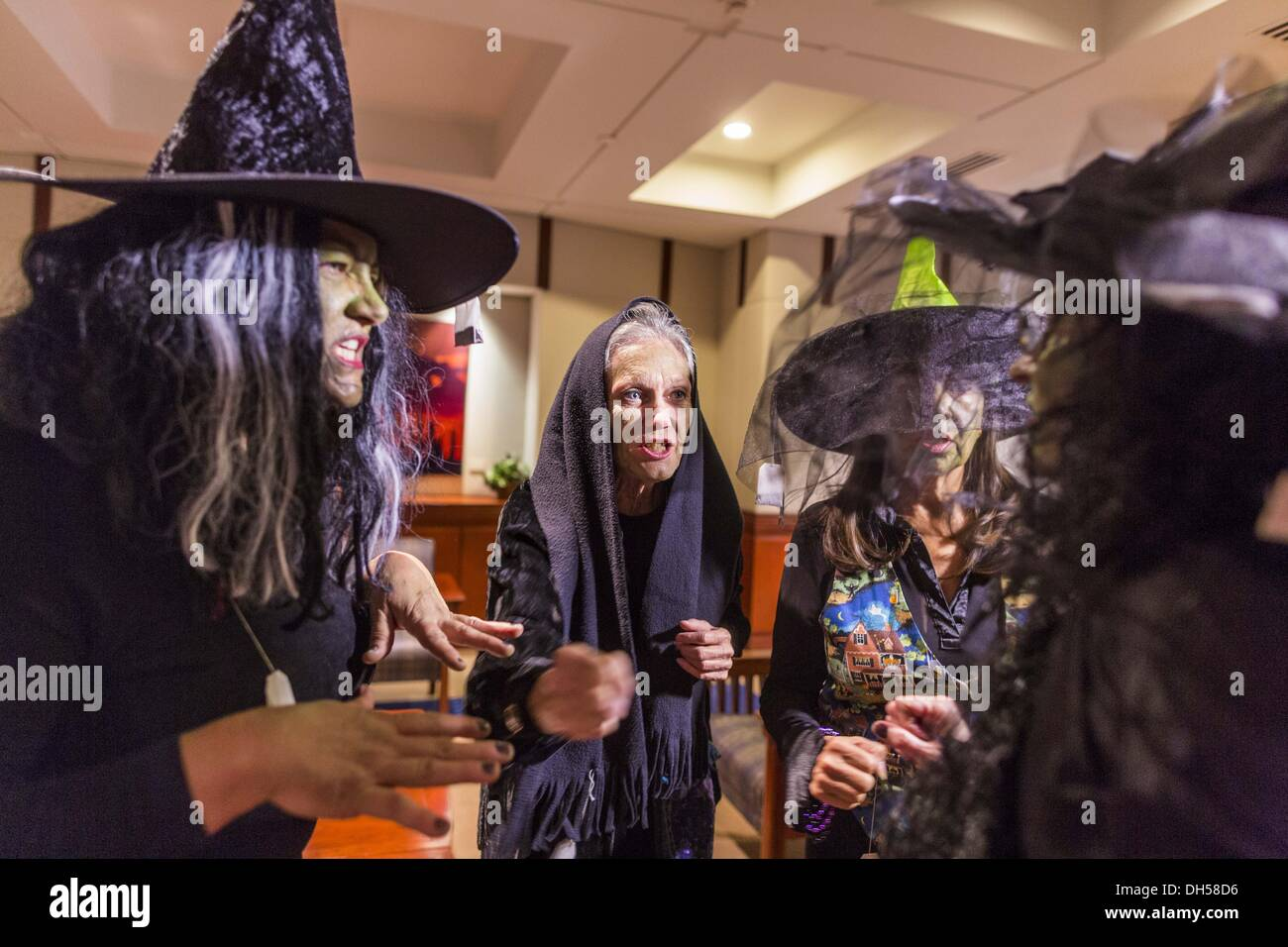 Phoenix, AZ, USA. 31st Oct, 2013. Immigration activists dressed as Halloween witches conjure a spell against Arizona Governor Jan Brewer Thursday. About 20 supporters of the DREAM Act and the deferred action program of President Barack Obama visited the office of Arizona Governor Jan Brewer to protest her decision to deny drivers licenses to Arizona DREAMERS and immigrants granted deferred action status by immigration authorities. Credit:  ZUMA Press, Inc./Alamy Live News - Stock Image