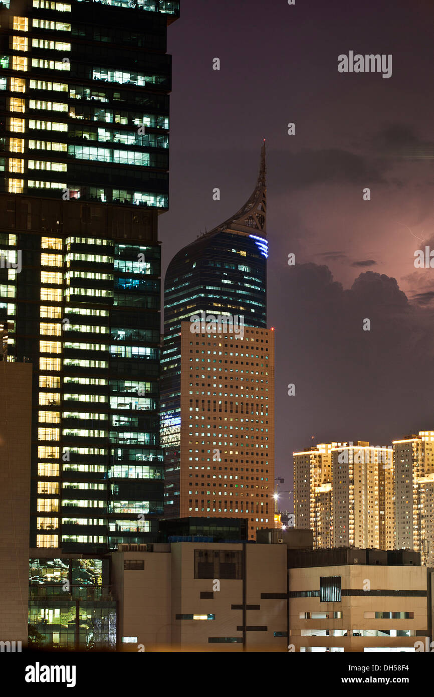 High-rise buildings in front of storm clouds, Jakarta, Java, Indonesia - Stock Image