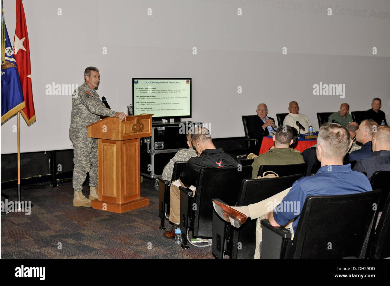 Maj. Gen. John W. Nicholson Jr., commander of the 82nd Airborne Division, addresses Operation Urgent Fury veterans and present-day division leaders at the Airborne and Special Operations Museum in Fayetteville, N.C., Oct. 25. The division's 2nd Brigade Co - Stock Image