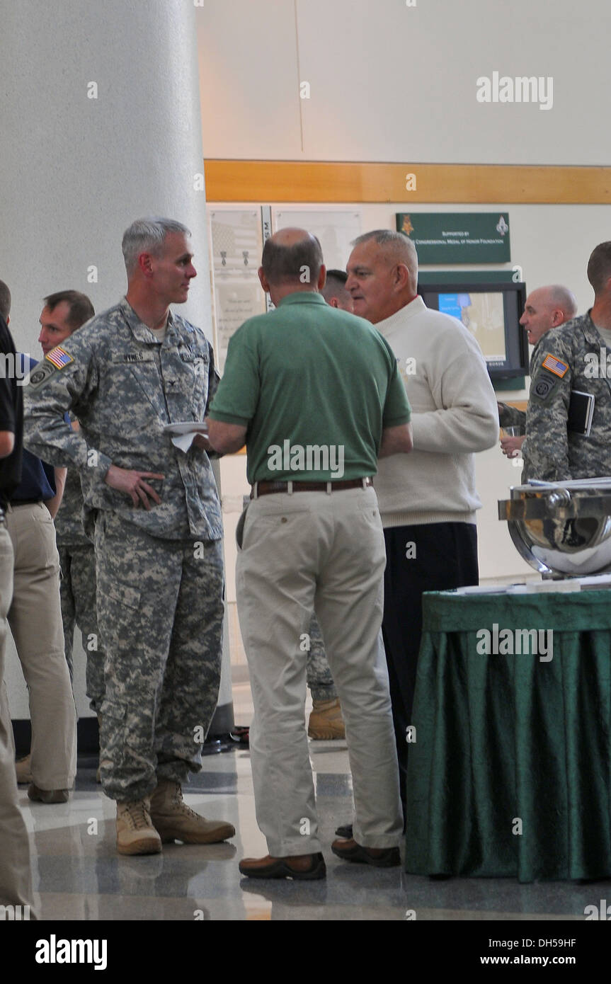 Col. Patrick Hynes, commander of the 2nd Brigade Combat Team, 82nd Airborne Division, speaks with Col. (ret.) Jack L. Hamilton (center) and Maj. Gen. (Ret.) Stephen Silvasy, Jr. at the Airborne and Special Operations Museum in Fayetteville, N.C., Oct. 25. - Stock Image