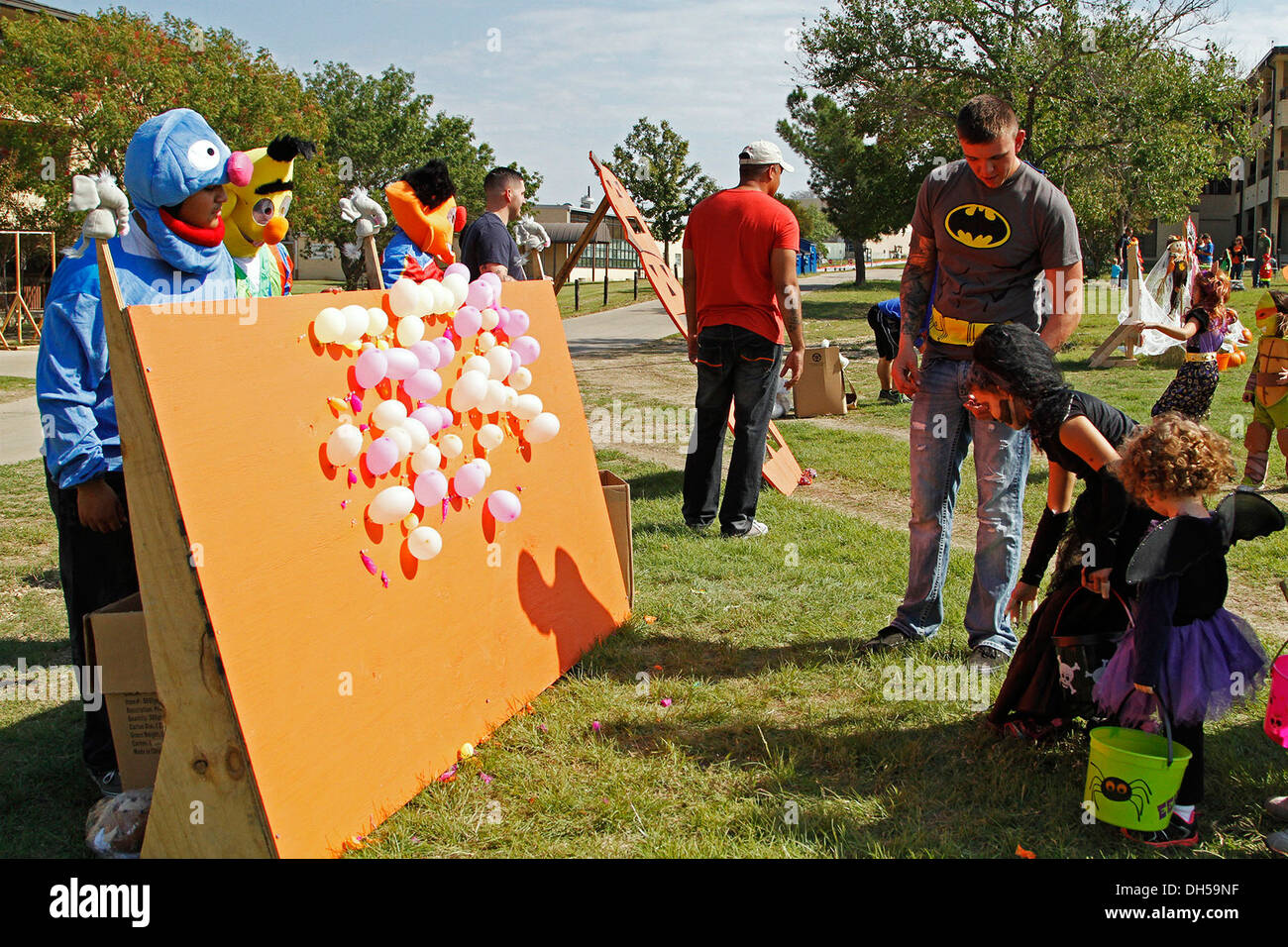 A 1st 'Ironhorse' Brigade Combat Team, 1st Cavalry Division child plays a balloon pop carnival game at the Ironhorse Fall Festival and Trunk or Treat, Oct. 26, at Fort Hood, Texas. The array of games included lawn darts, bean bag toss, ladder-ball, a scav - Stock Image
