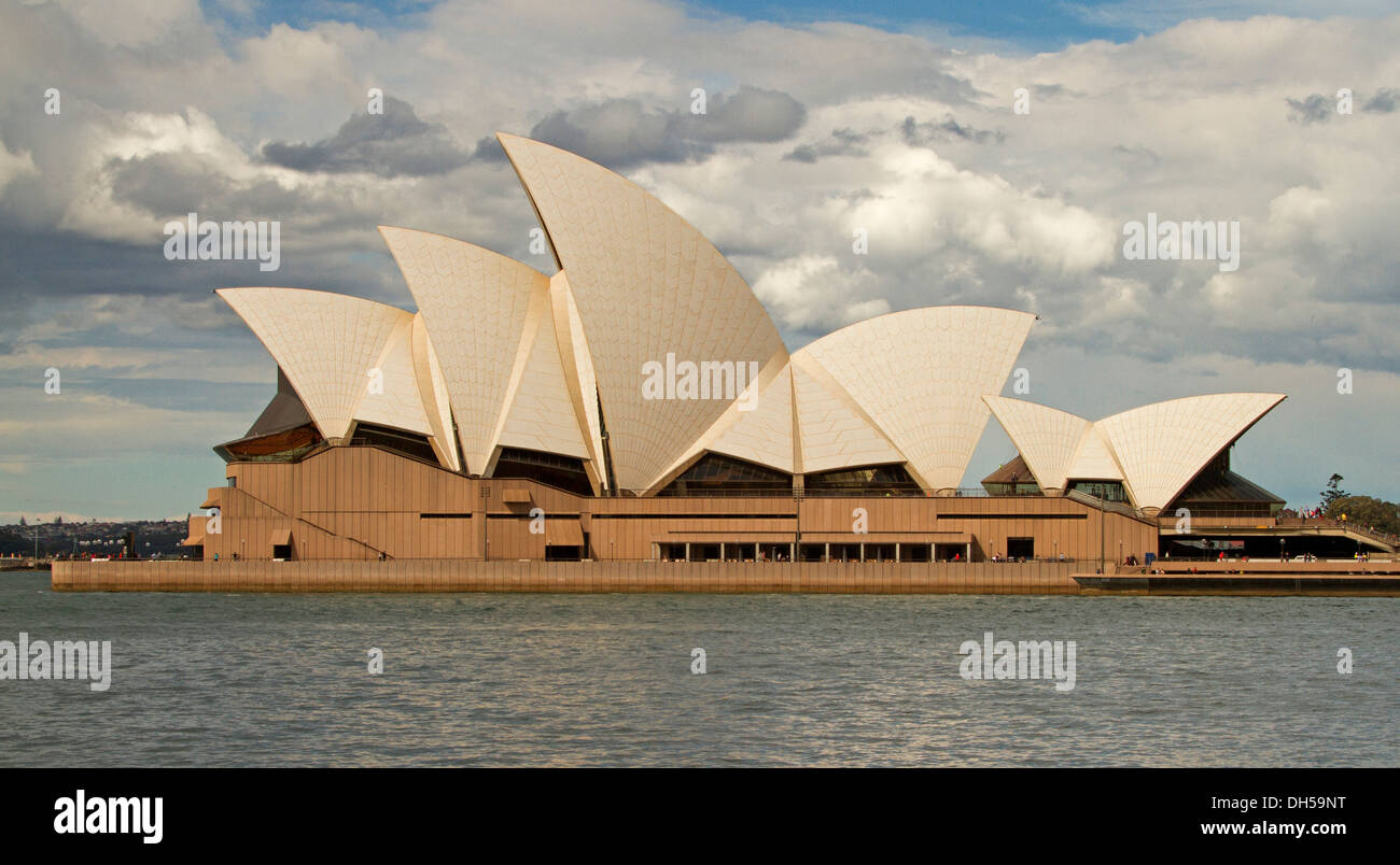 Sydney opera house, iconic building beside water of harbour in capital city of NSW Australia - Stock Image