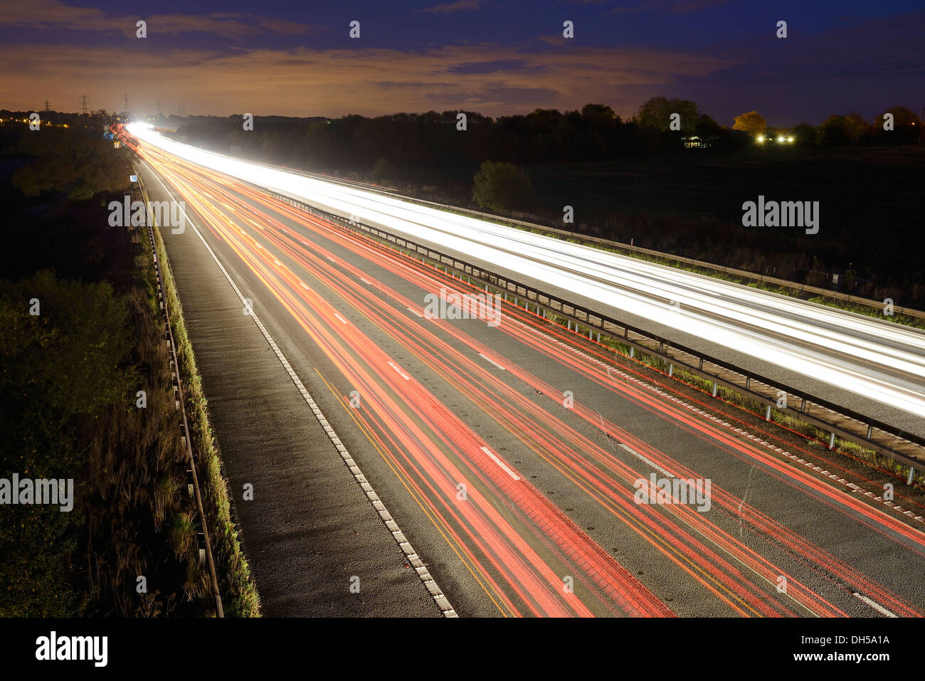 Long time exposure of evening traffic on the M56 motorway UK - Stock Image