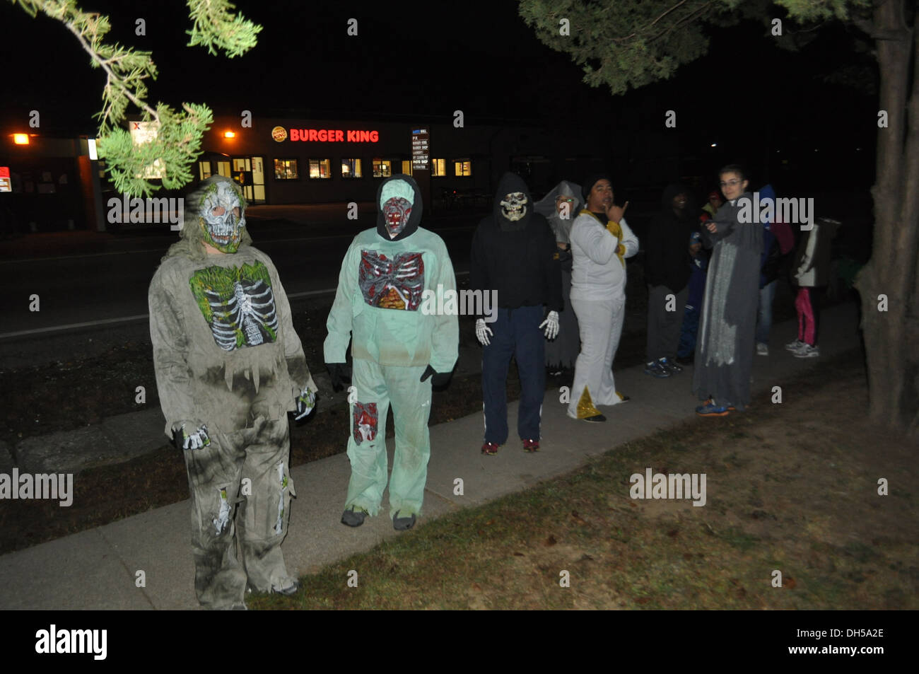 Soldiers from 70th Brigade Support Battalion, 210th Fires Brigade, 2nd Infantry Division, show off their Halloween costumes before beginning a battalion Halloween fun run. This run focused on building unit cohesion and morale throughout the unit. - Stock Image