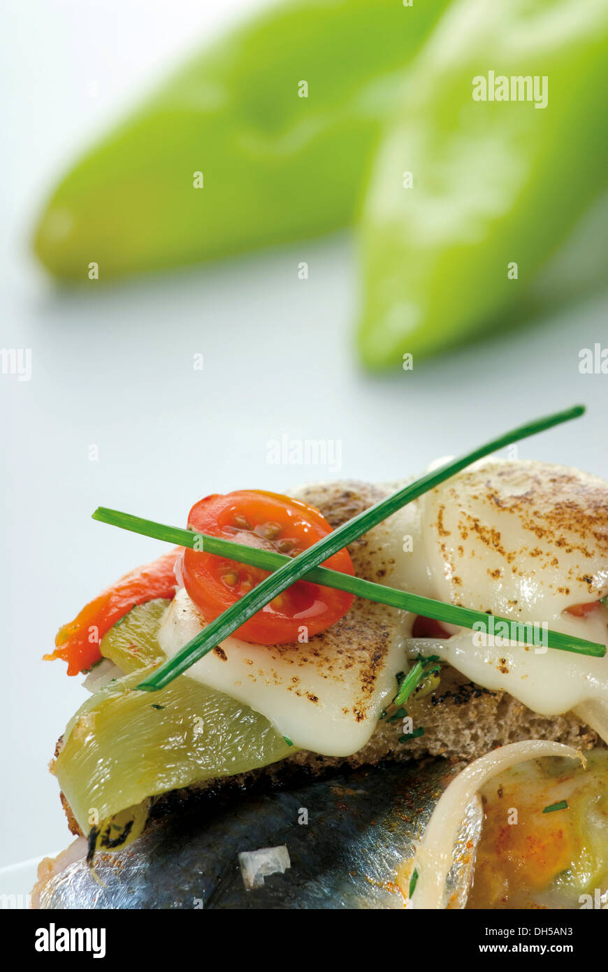 Peppers and anchovies, gratinated with melted cheese - Stock Image