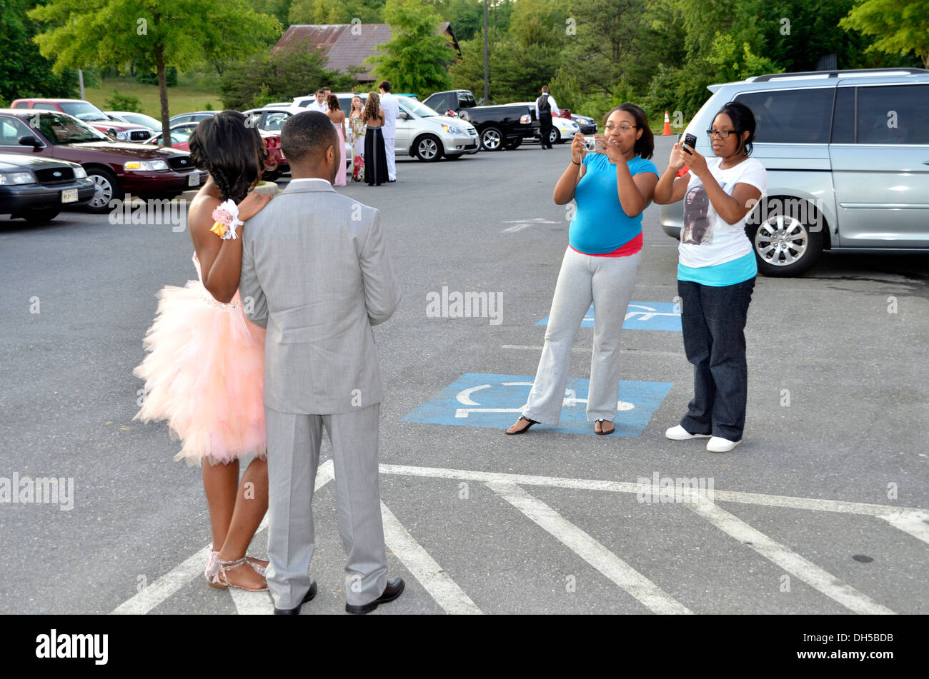 Relatives line up to take pictures of a couple at their high school prom in Dunkirk, Md - Stock Image