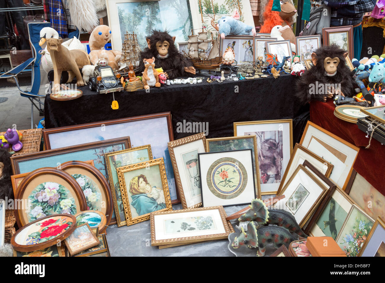 Stall selling variety of second hand items in Brick Lane Market, Tower Hamlets, London, England, UK - Stock Image