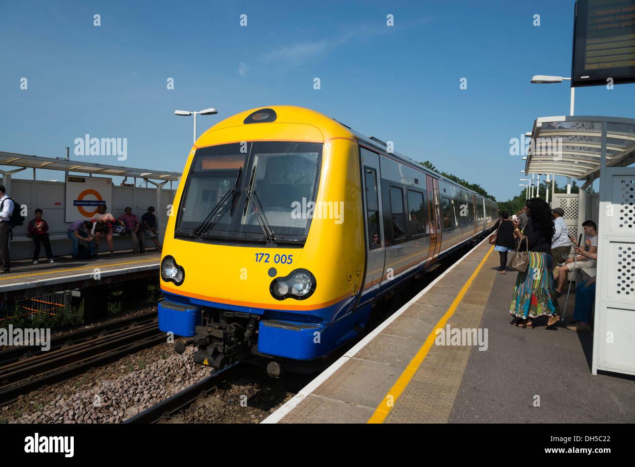 London Overground train pulling into Harringay Green Lanes station, London, England, UK - Stock Image