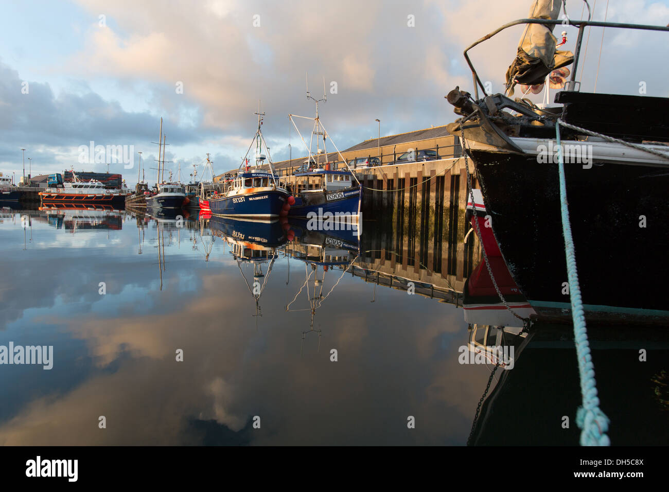 Islands of Orkney, Scotland. Picturesque early evening view of fishing boats tied-up alongside Kirkwall's harbour Stock Photo