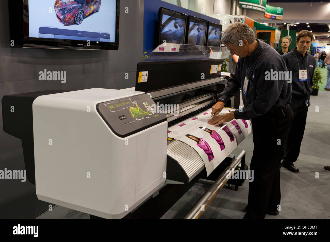 Man using large format Epson printer - Stock Image