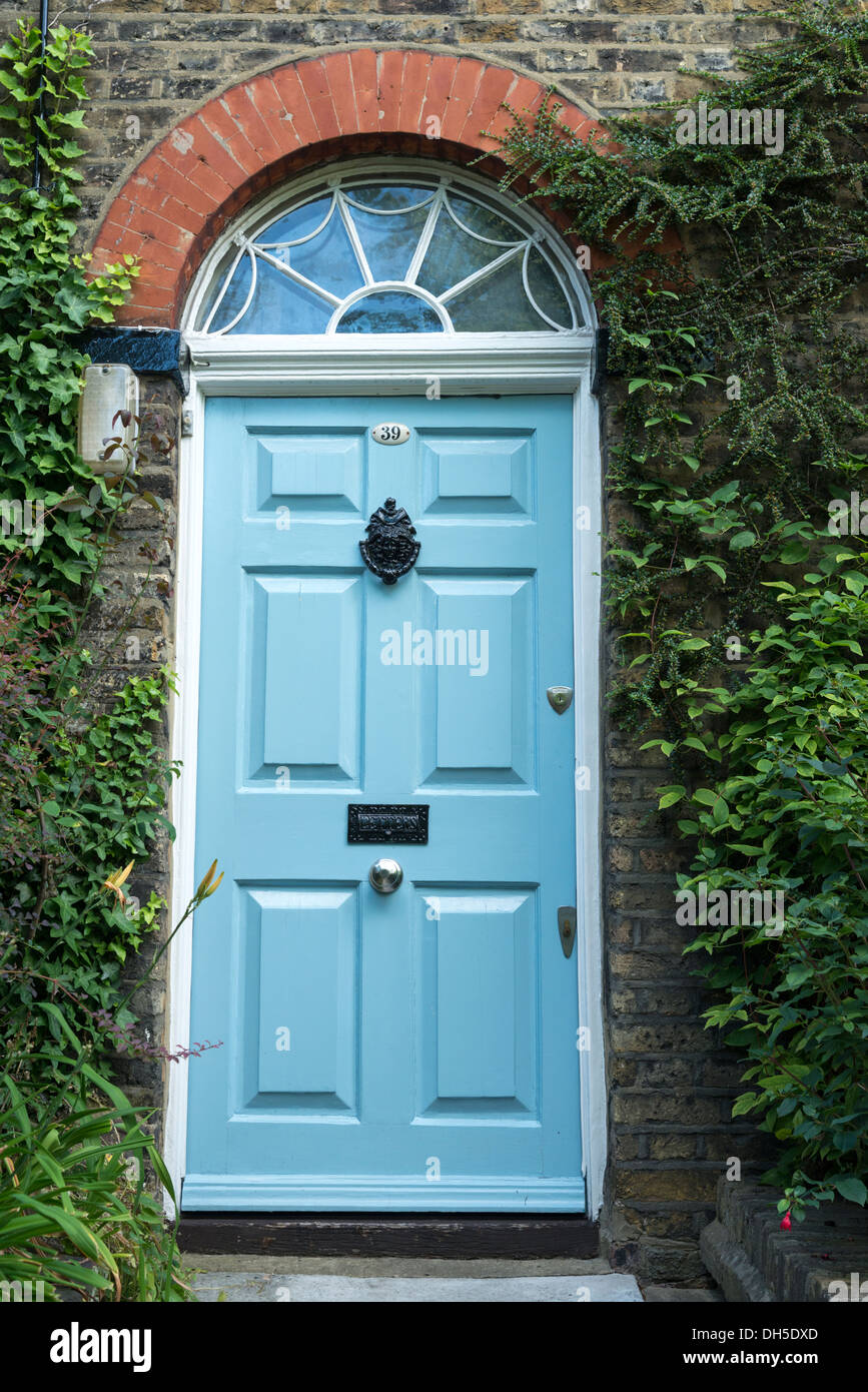 Blue door to house in Flask Walk, Hampstead, London, England, UK - Stock Image