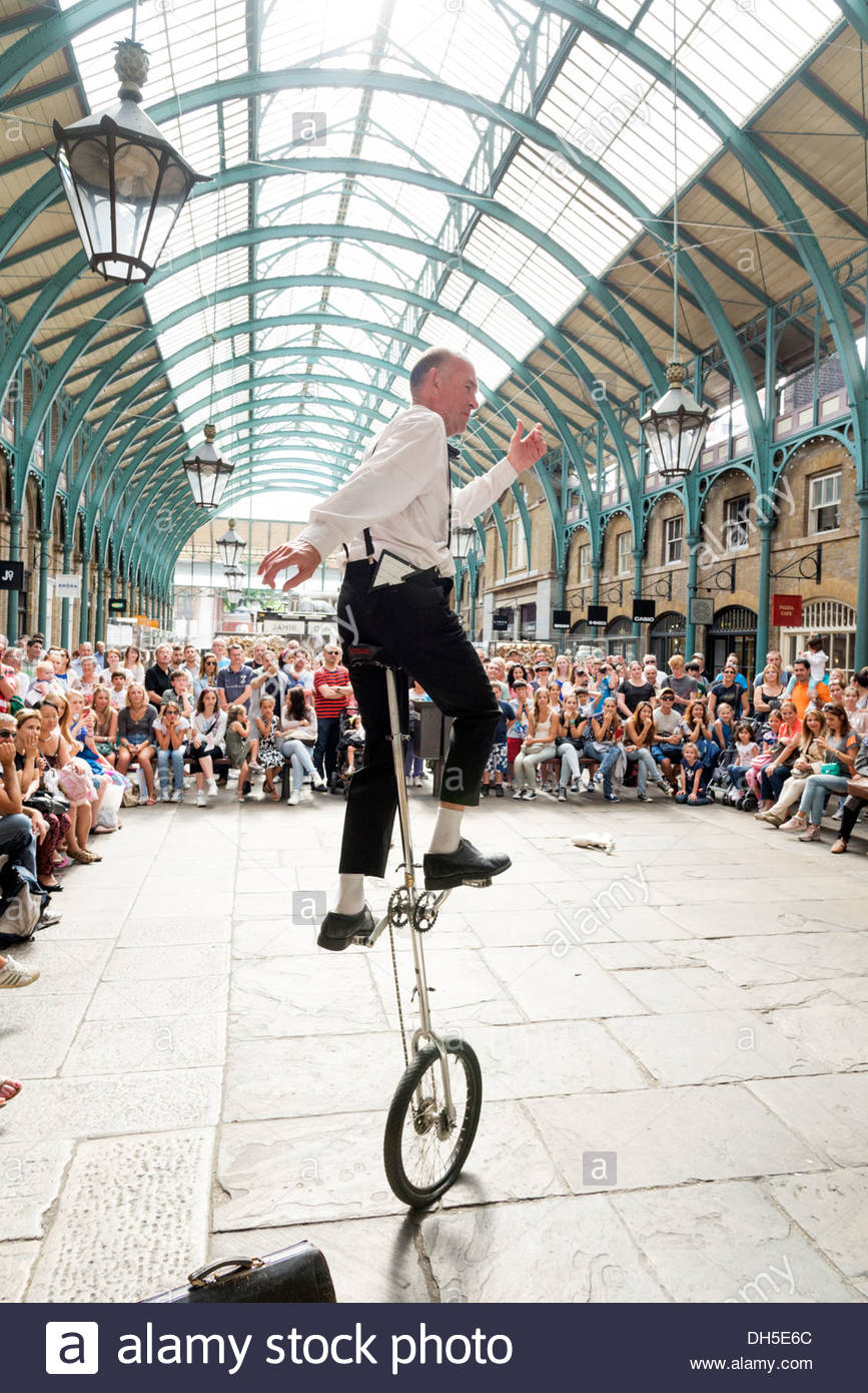 Unicycle performer in Covent Garden, London, England, UK - Stock Image