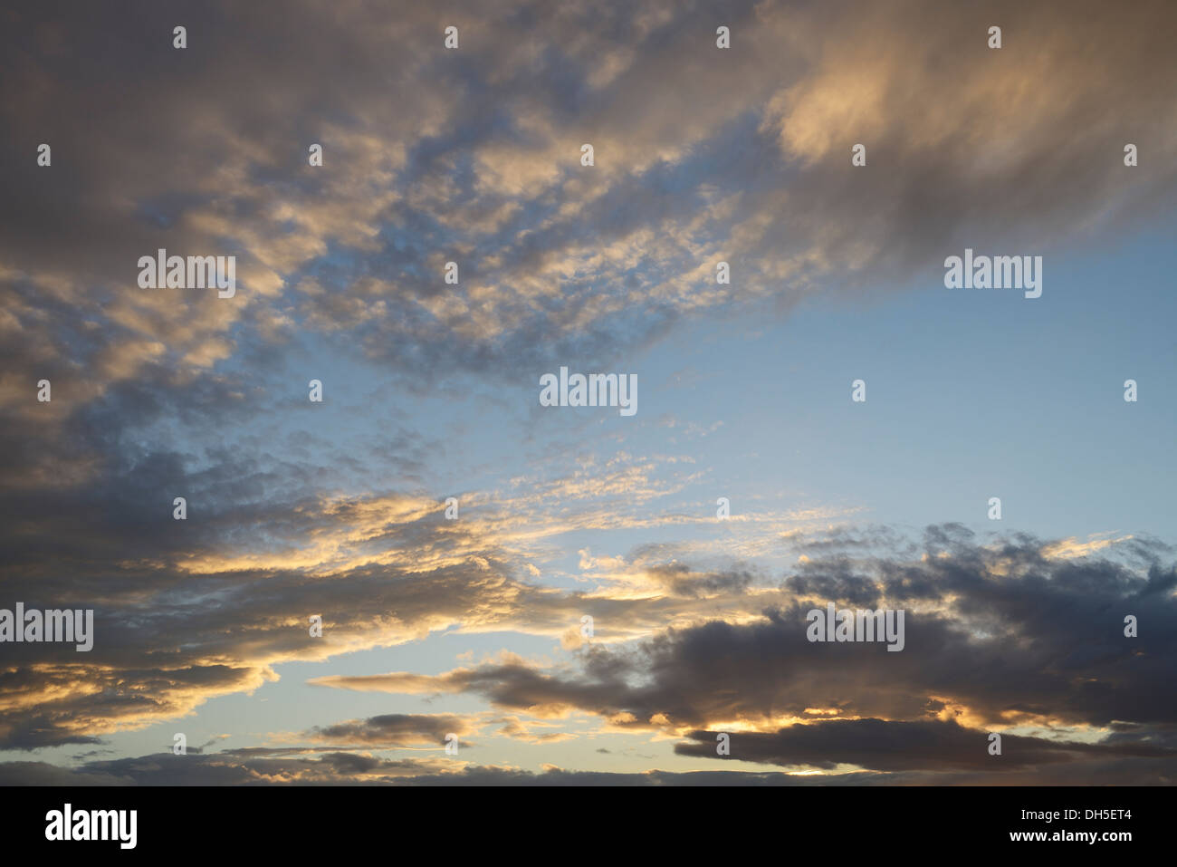Late evening sky and clouds as the sun sets UK - Stock Image