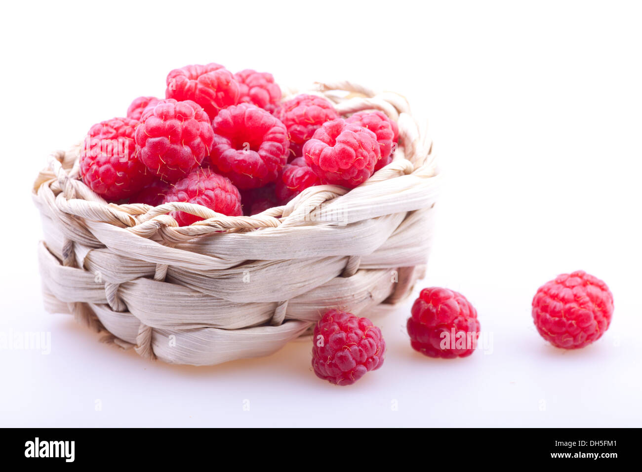 Bast-basket with a raspberry - Stock Image
