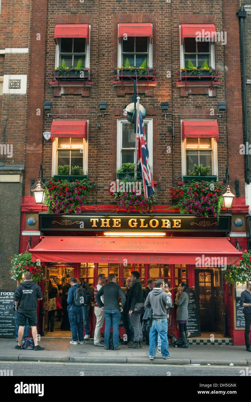 People drinking outside The Globe pub, Bow Street, London, England, UK Stock Photo