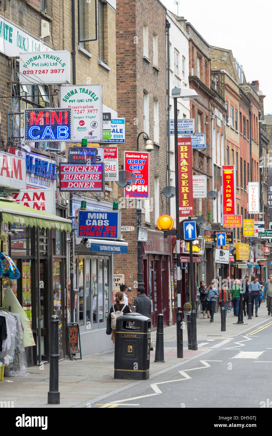 Restaurant and takeaway signs on Brick Lane, Tower Hamlets, London, England, UK - Stock Image