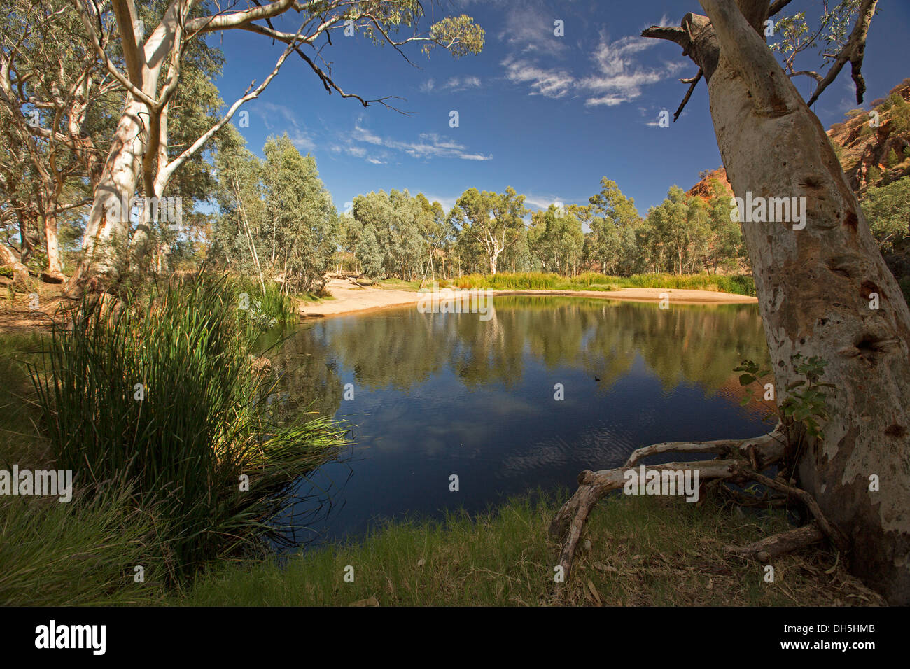 Picturesque outback landscape with blue pool / oasis at Ellery Creek Big Hole in West MacDonnell ranges near Alice Springs NT - Stock Image