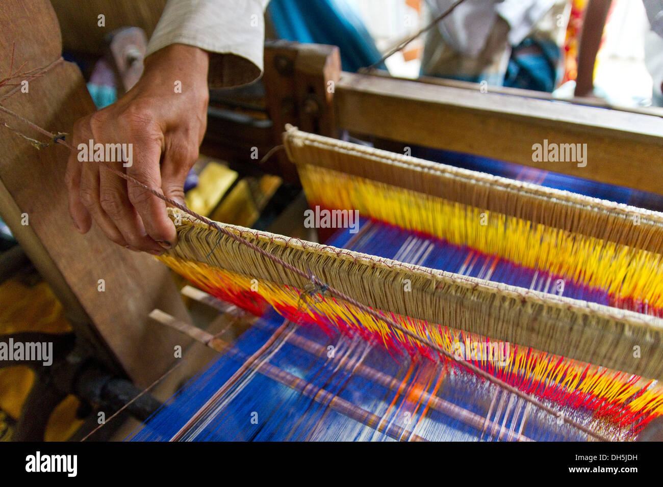 Hand at the loom, the establishment of the loom takes a day, 2300 threads have to be pulled twice by hand through eyelets - Stock Image