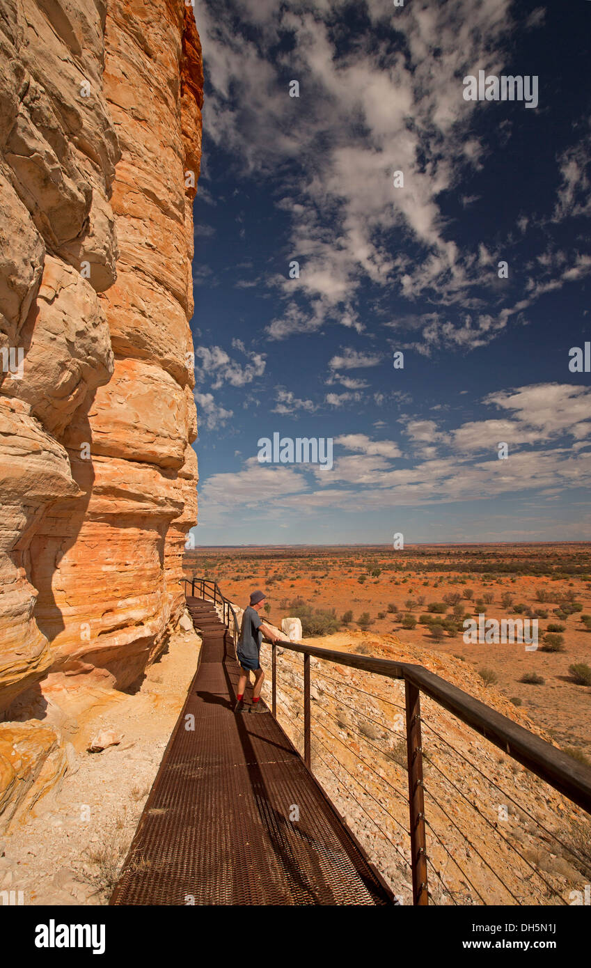 Immense rock - Chambers Pillar - and Australian outback landscape with plains stretching to distant horizon viewed from lookout - Stock Image