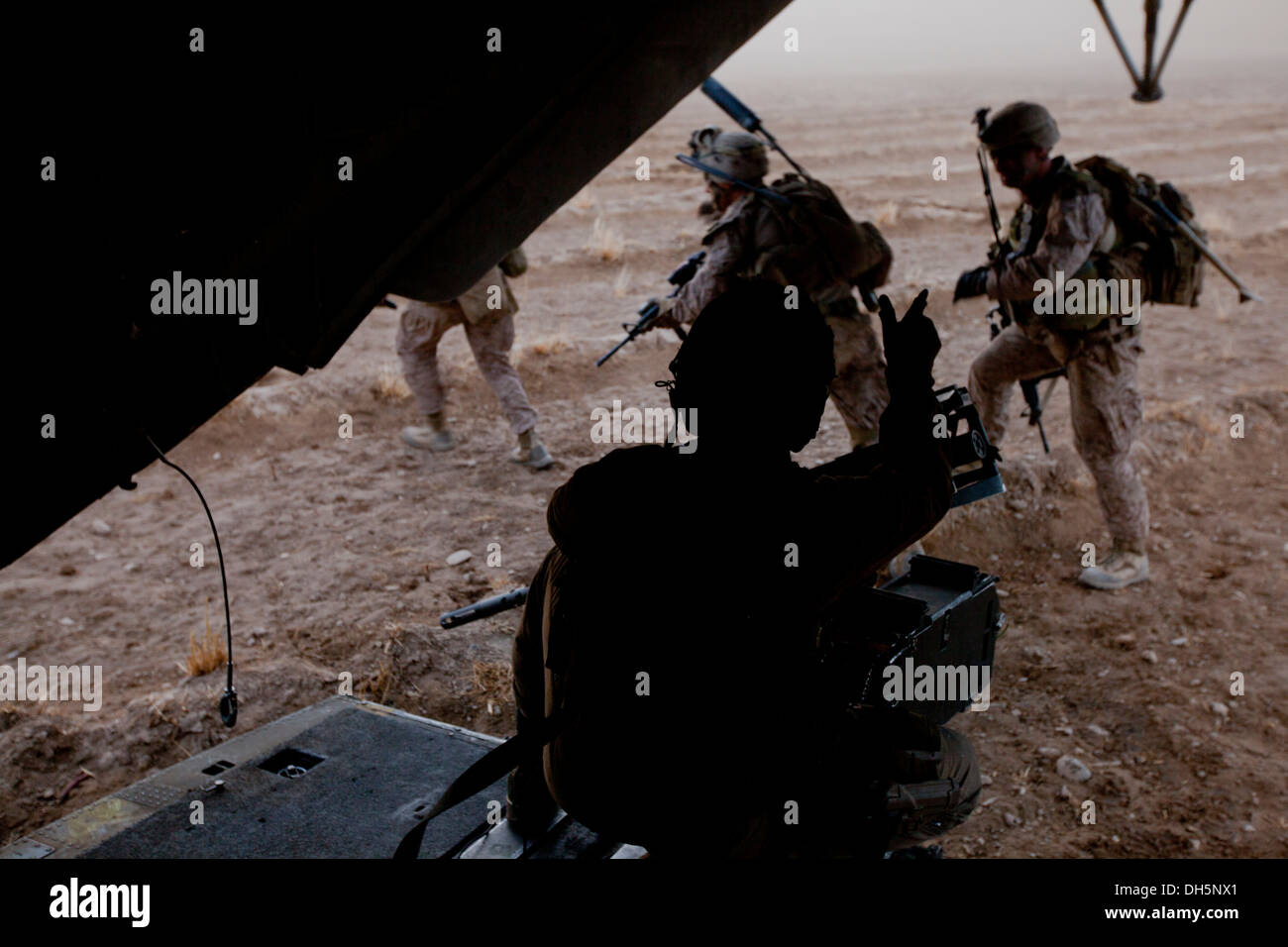 U.S. Marine Corps Cpl. Ryan L. Avery, center, a crew chief with Marine Heavy Helicopter Squadron 462 (HMH-462), Stock Photo