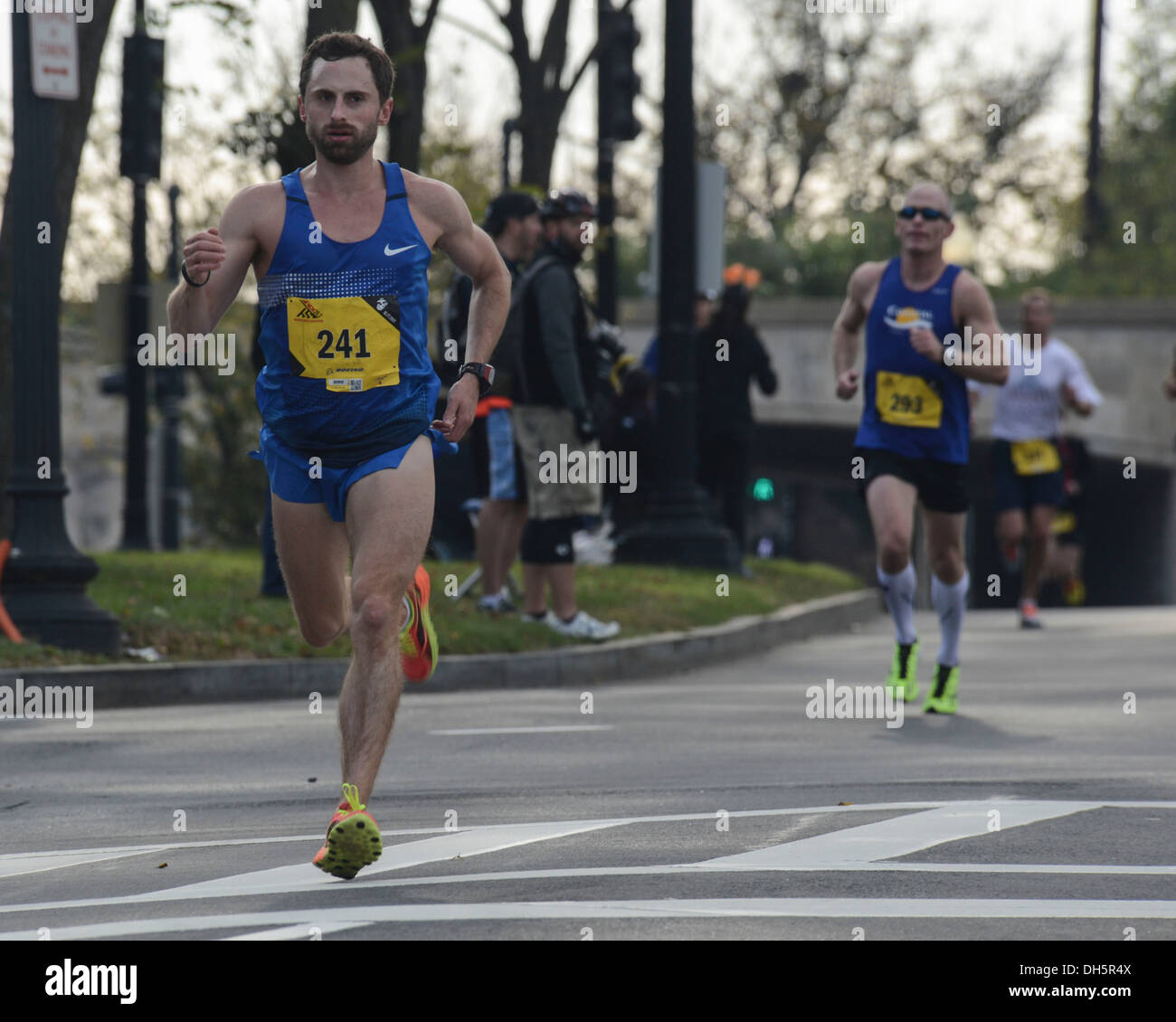 Runner Jeff Savage participates in the Thirty-eighth Annual Marine Corps Marathon, Oct. 27, 2013. Known as 'The People's Marathon,' the 26.2 mile race, rated the 3rd largest marathon in the United States in 2012, drew 30,000 participants. - Stock Image