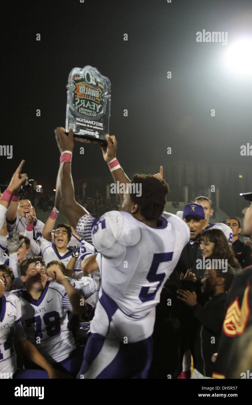 The St. Augustine football team celebrates their victory of the Great American Rivalry Series against Cathedral Catholic High School at CCHS, San Diego, Oct. 25. The St. Augustine Saints won 19-7. - Stock Image