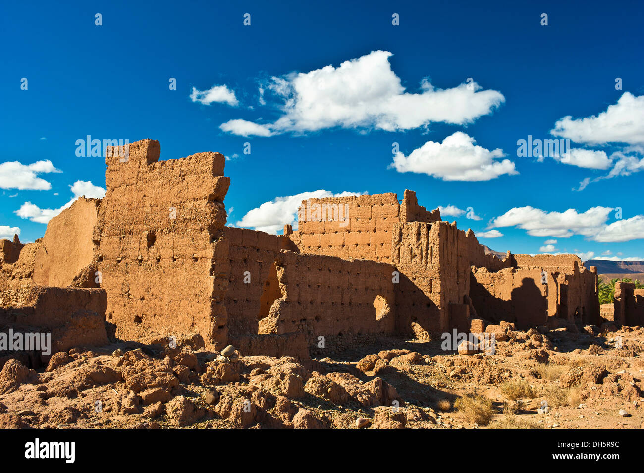 Derelict kasbah, mud brick fortress of the Berber people, Tighremt, Draa Valley, southern Morocco, Morocco, Africa - Stock Image