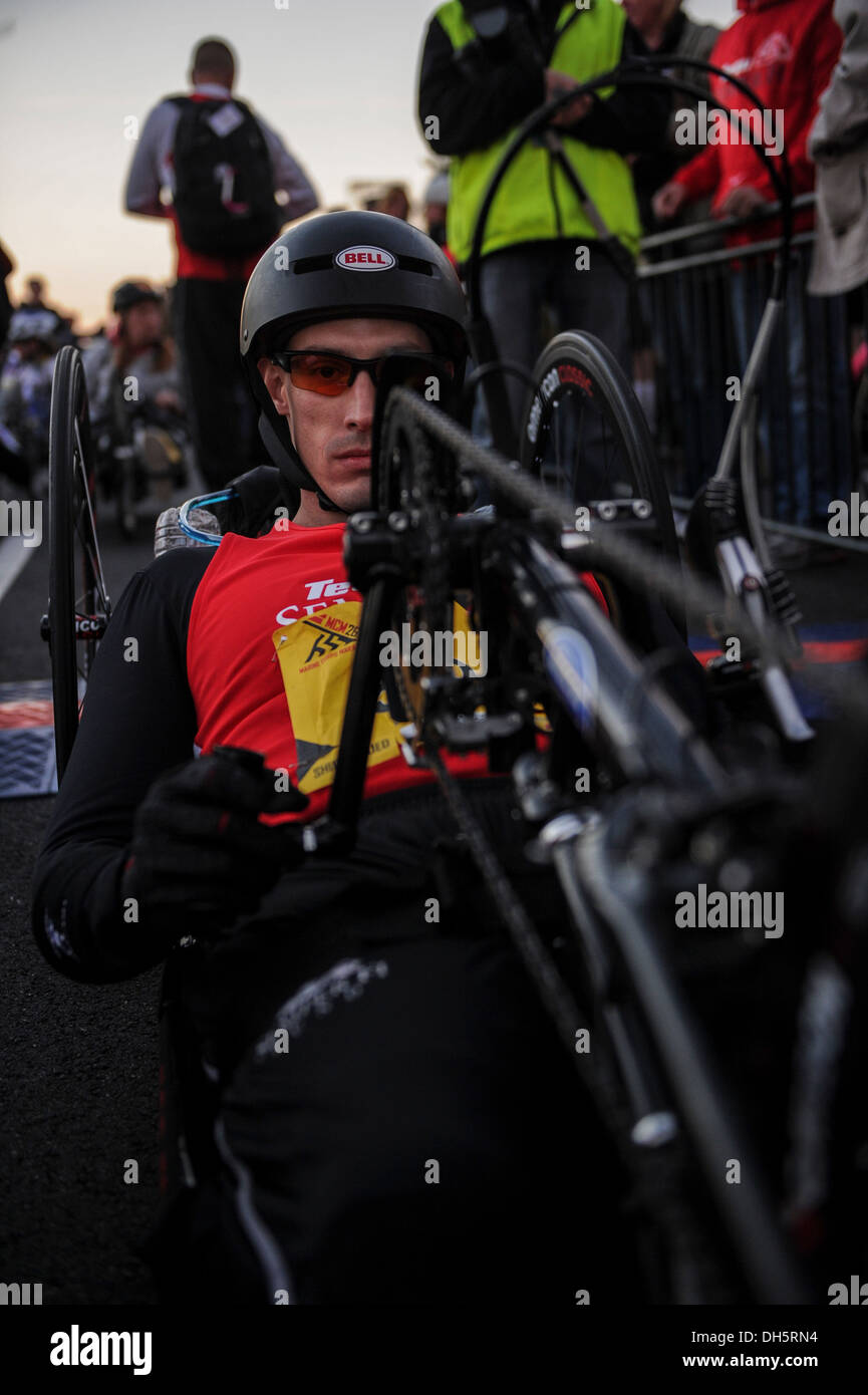 Cyclist Johnny Jones of the Semper Fi team participates for the 2nd time in the 38th annual Marine Corps Marathon held on Oct. 27, 2013 in Arlington, Va and runs through historic Washington, DC. Known as 'The People's Marathon,' the 26.2 mile race, rated - Stock Image