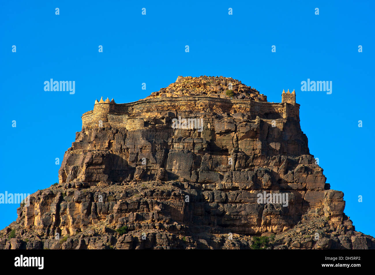 The impressive Agadir Id Aissa, fortified castle on a crag, Amtoudi, Anti-Atlas or Lesser Atlas mountain range, southern Morocco - Stock Image